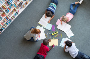 kids-drawing-and-writing-in-classroom